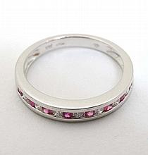 An 18ct white gold diamond and ruby half eternity ring