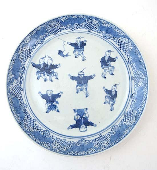 A 19thC Chinese blue and white plate deciding
