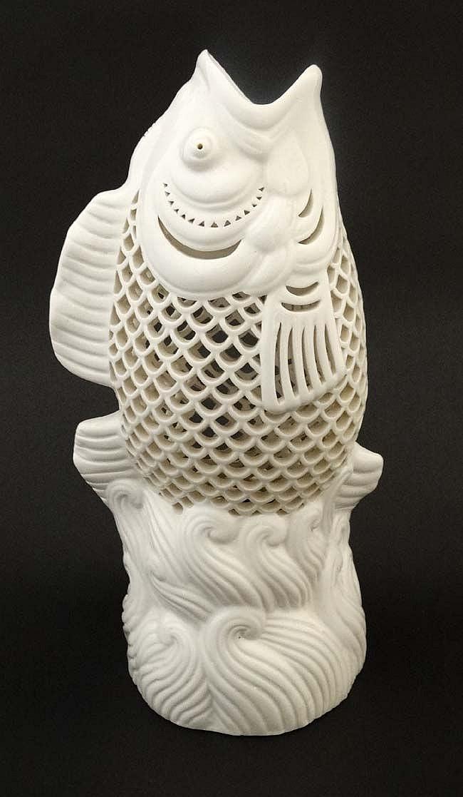 An oriental pierced blanc de chine leaping koi fish vase be for Koi fish vase