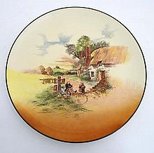 A Royal Doulton  '' Rustic England '' wall charger D5694 with green border.