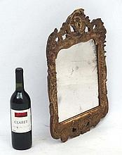 An 18thC Continental carved wooden wall mirror with Rococo style decoration