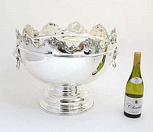 An impressive large pedestal silver plate wine cooler with lions mask handl