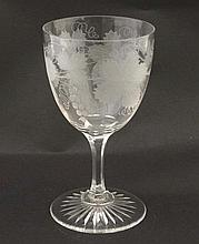A wine /  Barley Wine glass with etched fruiting vine decoration 7'' high