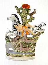 A Victorian Staffordshire spill vase depicting the