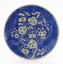 An Oriental large circular plate decorated with