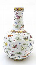 A Chinese onion vase, decorated in polychrome with