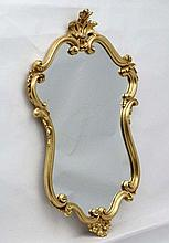 A 21stC gilt Rococo wall mirror . 38'' high x 26'' wide