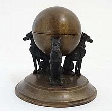 A 21stC after the Regency, cast bronze inkwell depicting three greyhounds s