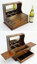A c.1900 oak Tantalus with mirror back, bramahah locking cigar section and