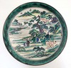 A green and white Japanese plate decorated with figures beside a river in a, A. (1844) Green, £32