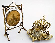 A 19thC brass dinner gong together with a desk inkwell / letter rack. the g