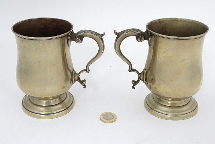 A pair of tankards with acanthus decoration to handles and e for Acanthus decoration