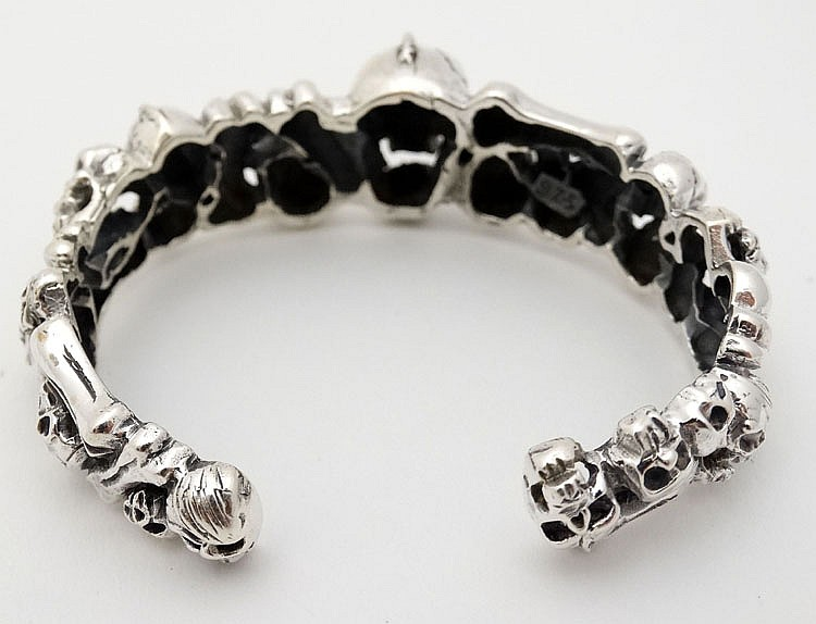 A silver bangle bracelet with skull decoration Home decoration with bangles