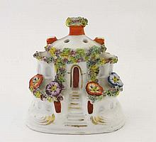 A 19th Century cottage pastille burner, the round