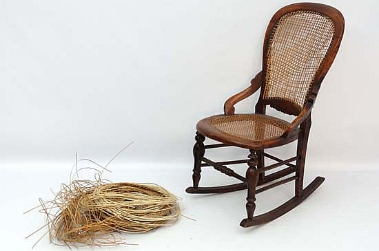 A Victorian Stained Walnut Rocking Chair Wi