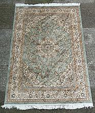 Carpet / Rug : A machine made prayer rug , in the Aubusson style , with a central ground of sage green with black, gold, buff colours with a double thin banded single wide band , 52 x 80''.