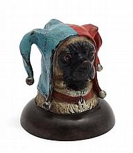 A decorative cold painted bronze novelty inkwell formed as the head of a pug dog wearing a jester hat. Late 20thC.  3 3/4''