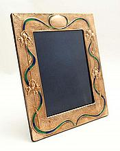 A copper photograph frame with embossed iris and enamel decoration in the Art Nouveau style. 21stC The whole 11 1/24'' x 9 1/4''
