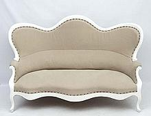 A 19thC Continental shaped settee with white painted wooden frame and calico like upholstery. 68'' wide x 42'' high