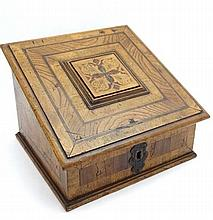 A late 19thC Low Countries fruitwod writing / stationery box  with floral inlay to side, stringing  and painted polychrome decoration to the sloped hinged lid, opening to reveal a paper lined interior 10 1/2'' wide x 8'' high x 9 1/2'' deep