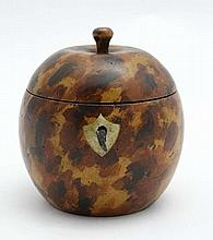 A Folk Art treen tea caddy formed as stylised apple, with painted faux tortoiseshell decoration.  Late 20thC.  4 1/2'' high
