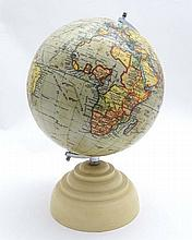 A mid 20thC 'Geographia' 8 inch Terrestrial Globe on cream Bakelite base. Approx 12 1/2'' high