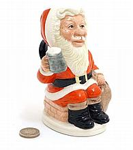 A limited edition 1993 Royal Doulton toby jug ''Father Christmas'' , number D6940, number 1179 of 3500, modelled by William K Harper, bears festive factory stamp to base. 5 1/4'' high.