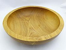 A large wooden fruit bowl. 16'' diameter approx 4'' high