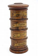 Kitchenalia:  A treen spice tower comprising 4 sections labelled ' Nutmeg' 'Mace'  ' Ginger' and 'Cloves' . Approx 7 1/2'' high