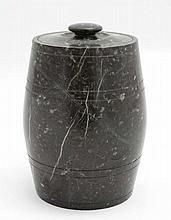 A barrel formed lidded jar of carved and polished green serpentine like stone. Approx 6 1/2'' high