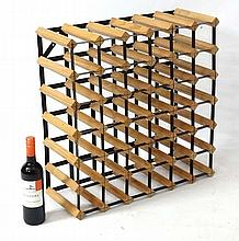 A 36 bottle wine rack of wood and metal construction 24 1/2'' high x 24'' wide