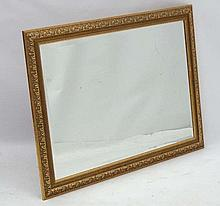 A late 20thC g wall mirror with gilt acanthus relief surround and bevelled glass mirror, 28 1/2 x  40 1/2''