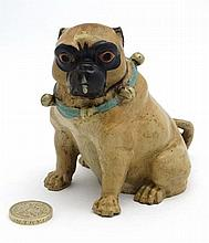 A late 20thC decorative cold painted bronze novelty inkwell formed as a seated pug dog 3 3/4''