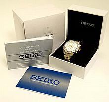 A Gentleman's Seiko wristwatch ( Analogue Quartz Cal. 4T57 1/10 Chronograph). Boxed
