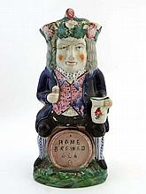 A 19th C Staffordshire pottery Toby jug sitting