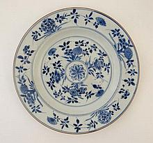 An 18thC Chinese plate profusely decorated with