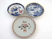Three Chinese saucer dishes : a blue and white
