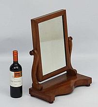 A 19thC mahogany toilet mirror on shaped base 15'' wide x 18 1/2'' high