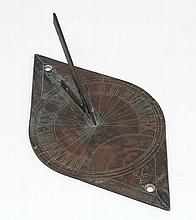 Bronze Sundial : an XVIII / XIX bronze  elliptical  shaped Sun Dial , marked with North and South and punchwork decoration.10 1/2'' long x 5 3/4'' wide.