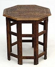 A circa 1900 Indian octagonal carved wood 2 part table , measuring 21'' diameter x 22 1/2'' high.