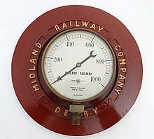 Midland Railway Co - Pressure gauge: A pounds per square inch large brass dial mounted in a Derby cast iron chapter ring on stand. The whole 12'' diameter