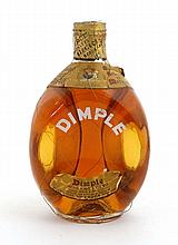 Kitchenalia : a vintage 1960's Dimple Whisky by John Haig & Co uncorked!  8'' high