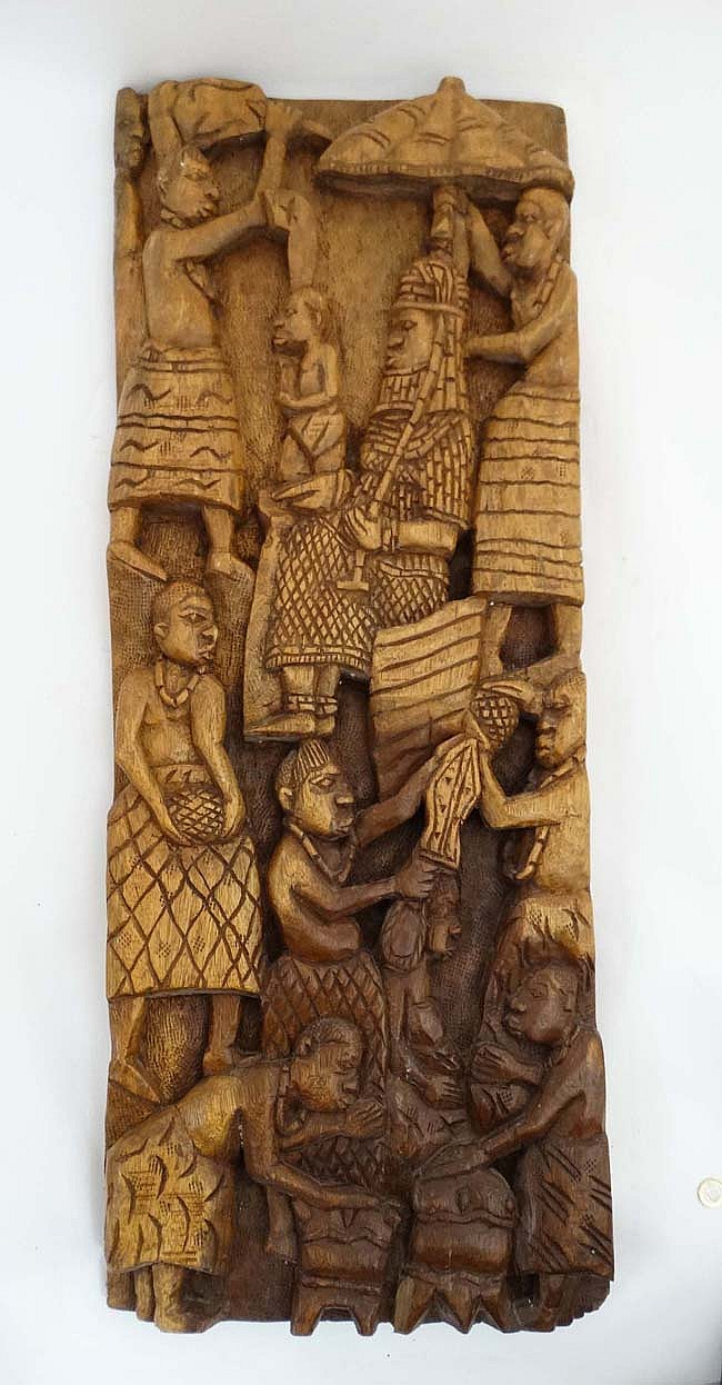 An ethnographic native tribal carved hardwood relief depicti