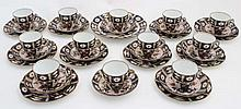 A collection of Crown Derby Imari pattern cups and saucers, to include 12 cups, 12 saucers , 10 side plates and 1 serving plate, pattern number 2192, some pieces marked, the cups 2 1/2'' high. (35)