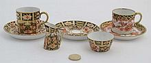An Imari pattern Royal Crown Derby c1919 cup and c1910 saucer in pattern number 2649 , together with early 20thC Royal Crown Derbytwo saucers, cup, miniature jug and miniature bowl in pattery number 2451, each piece bears factory stamp to base. 2''