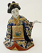 A Japanese figure of a sat kneeling Geisha having
