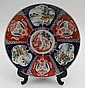 An Imari charger decorated in traditional palette