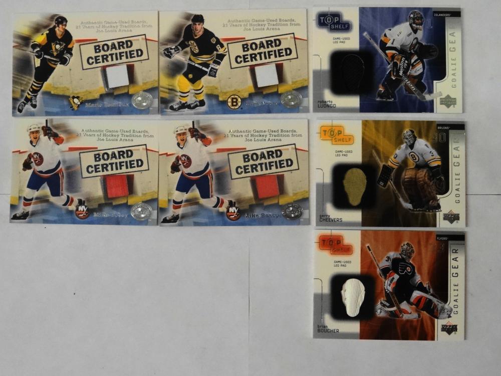 4 2001 FLEER USED BOARDS AND 3 2001 UPPER DECK GOALIE GEAR HOCKEY CARDS