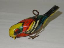 VINTAGE DECORATED STEEL WIND-UP HOPPING BIRD