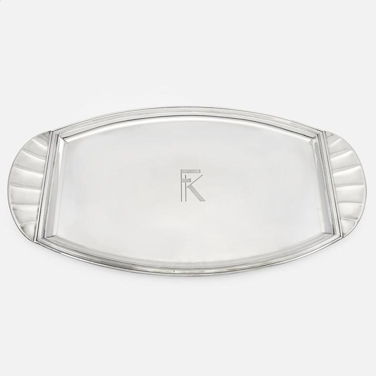 French Silver Tray   With flared handles, monogrammed. Length 28 inches (71.1 cm), approximately 142 ounces.
